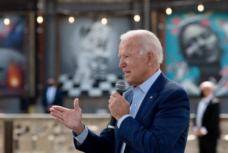 Democratic presidential candidate Joe Biden speaks at the Black Economic Summit at Camp North End in Charlotte, N.C., on Wednesday. In a letter, nearly 500 national security experts have endorsed Joe Biden for president.