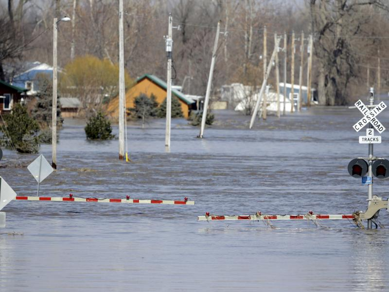 A railroad crossing is flooded with water from the Platte River in Plattsmouth, Neb. Record high floodwaters inundated regions of the Midwest following an intense winter storm and rapid snowmelt.