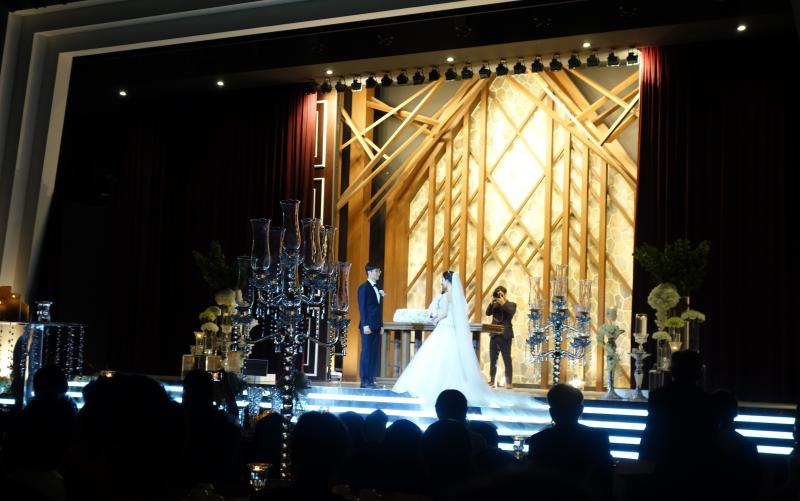A stage production or a Korean wedding? It can be hard to tell.