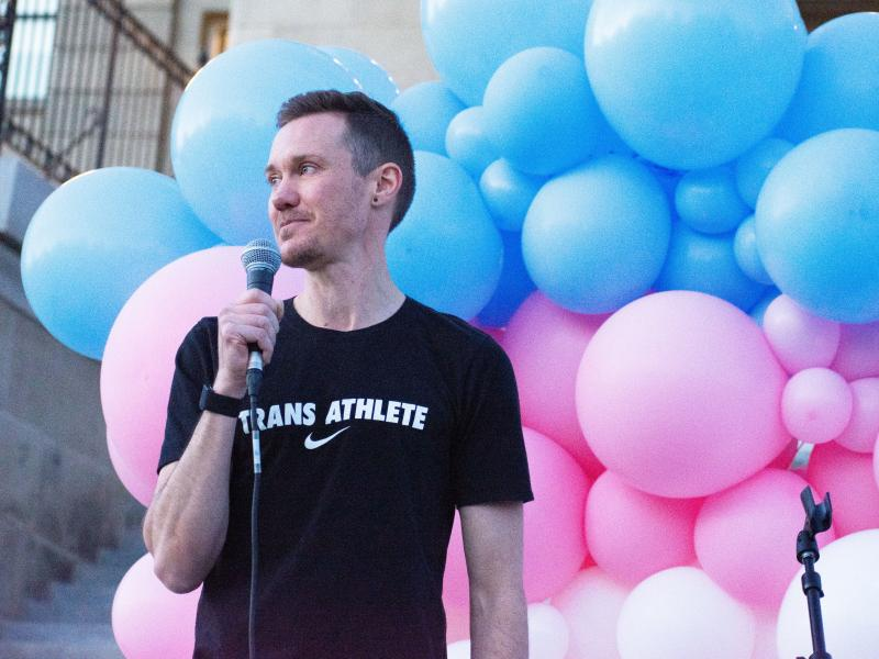 Chris Mosier, the first known transgender person to qualify for an Olympic trial, joined protesters in Boise, Idaho, to push back against legislation targeting transgender residents.