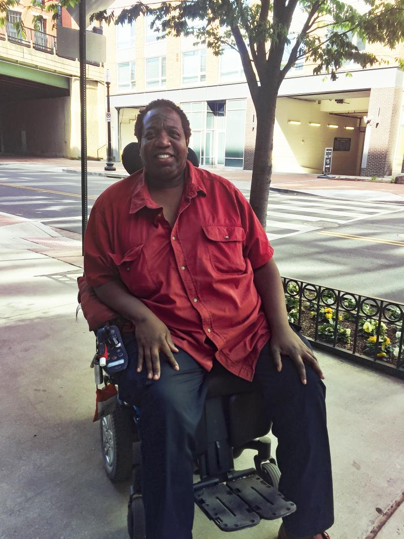 """Thomas Mangrum of Washington, D.C., has used a wheelchair for 15 years. The company that provides his helper --€"""" who assists him with his day-to-day activities — will have some tough choices to make once new regulations regarding overtime pay for low"""