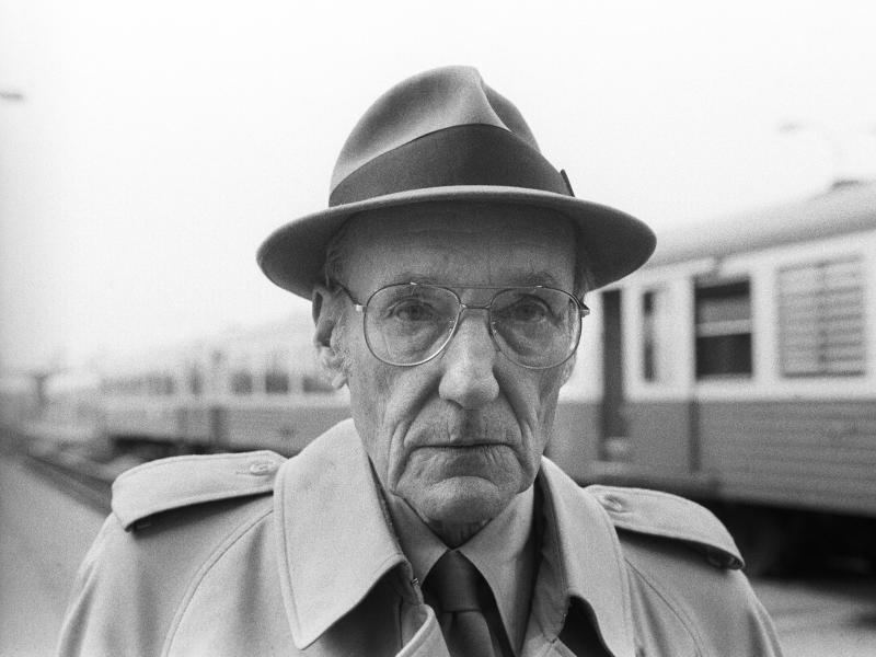 American writer William S. Burroughs poses during a portrait session at Bourges Railway Station on April 24, 1984 in Bourges, France.