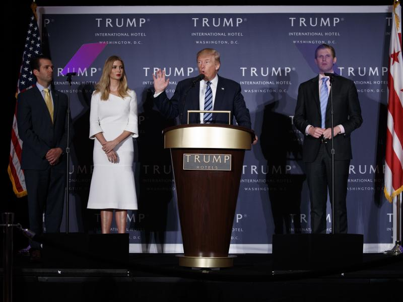 Donald Trump, accompanied by Donald Trump Jr. (from left), Ivanka Trump and Eric Trump at an event in 2016. New York Attorney General Barbara Underwood says the younger Trumps had exercised no real control over the Trump Foundation's activities, despite b