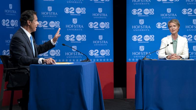 New York Gov. Andrew Cuomo answers a question as Democratic New York gubernatorial candidate Cynthia Nixon looks on during a gubernatorial debate at Hofstra University last month.