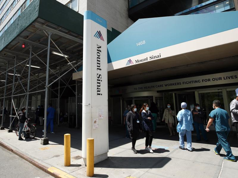 A view of the entrance to Mount Sinai Hospital in New York City on May 14, 2020. Hospital and nursing home workers across New York are required to have at least one dose of a COVID-19 vaccine by Monday, prompting concerns over noncompliance and potential