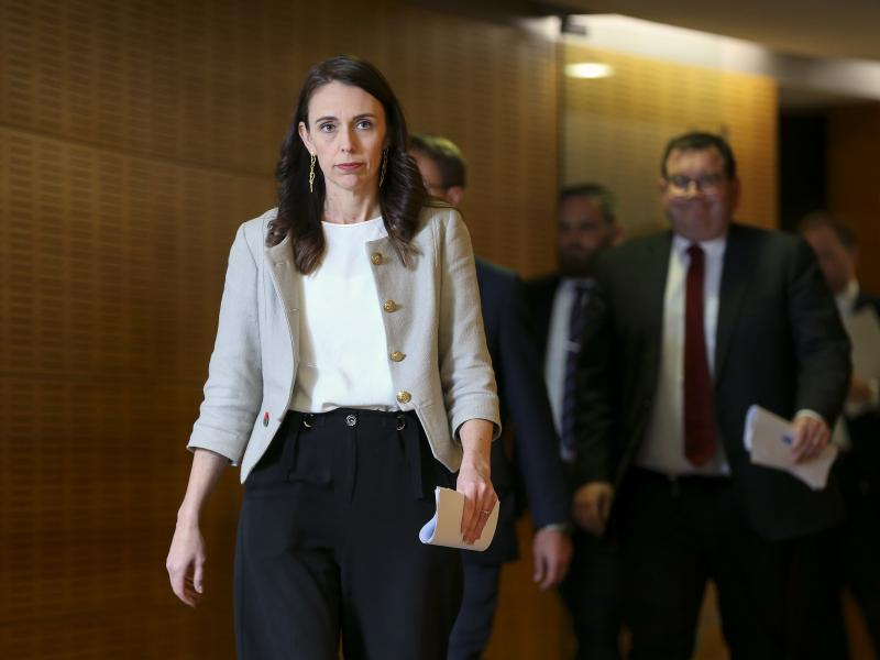 """New Zealand Prime Minister Jacinda Ardern arrives for a press conference Friday in Wellington. A new coronavirus outbreak has grown to 30 cases, and Ardern predicts of the cluster, """"It will grow before it slows."""""""