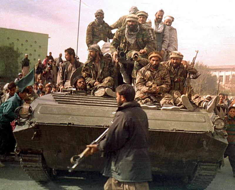 Security forces from the anti-Taliban Northern Alliance enter Kabul on Nov. 13, 2001.