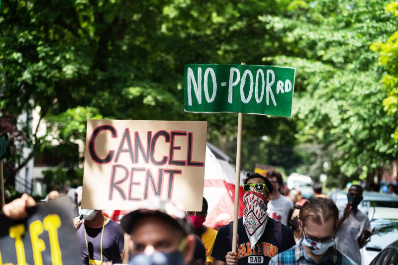 Demonstrators march in Chicago's Old Town neighborhood in June to demand a lifting of the Illinois rent control ban and a cancellation of rent and mortgage payments. The pandemic's financial pressures are causing many Americans to struggle with rent payme