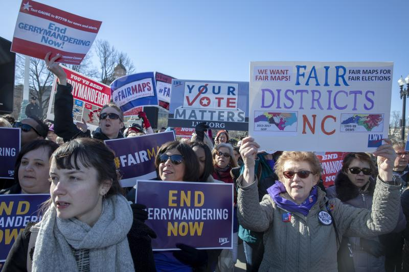 Protesters against gerrymandering at a March 2019 rally coinciding with Supreme Court hearings on major redistricting cases. After the court said the federal judiciary has no role in partisan redistricting cases, legal action is focused on state courts.