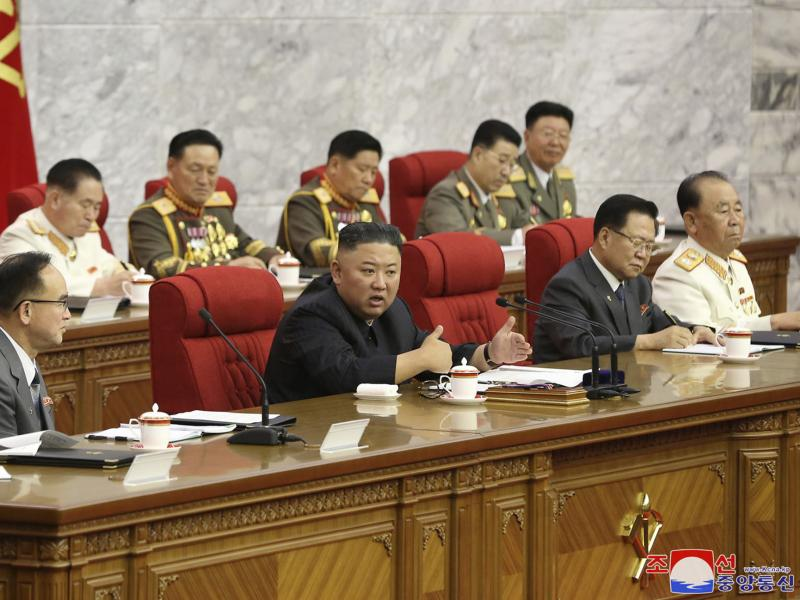 In this photo provided by the North Korean government, North Korean leader Kim Jong Un, center, speaks during a Workers' Party meeting Thursday in Pyongyang. Kim ordered his government to be fully prepared for confrontation with the Biden administration,