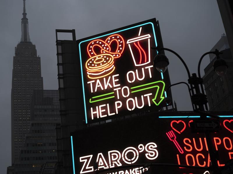 "A billboard in midtown Manhattan reads ""Take Out To Help Out, last month in New York."