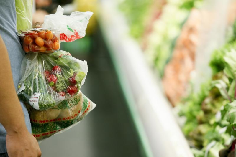 A shopper holds fresh produce at Northgate Gonzalez Market before a news conference there, where the Los Angeles County Department of Public Health announced new data on food insecurity in the county, in September 2017. Food insecurity affected 1 in 3 low
