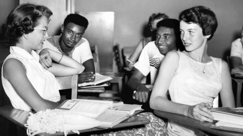 Students chat while waiting for history class to start at Oak Ridge High School in September of 1955, when the once all-white high school was desegregated by order of the Atomic Energy Commission. The Tennessee city's school board is now formally includin