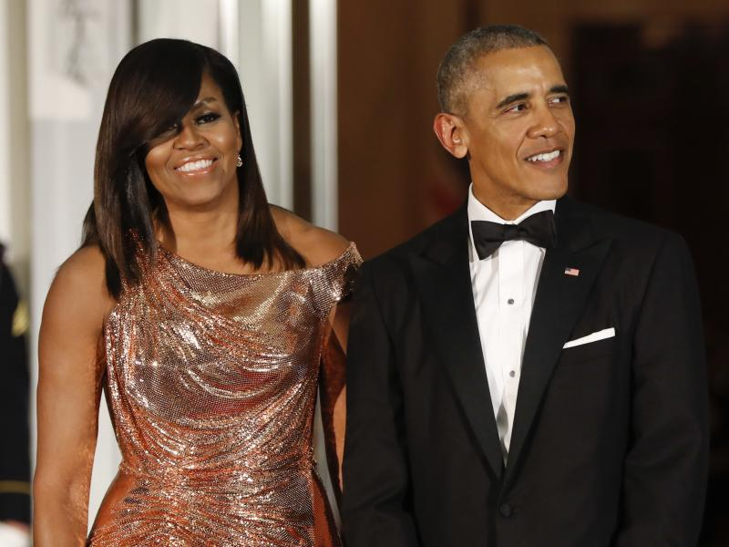 President Barack Obama and first lady Michelle Obama wait to greet Italian Prime Minister Matteo Renzi and his wife, Agnese Landini, for a State Dinner at the White House in Washington in 2016. Netflix says it has reached a deal with the Obamas to produce