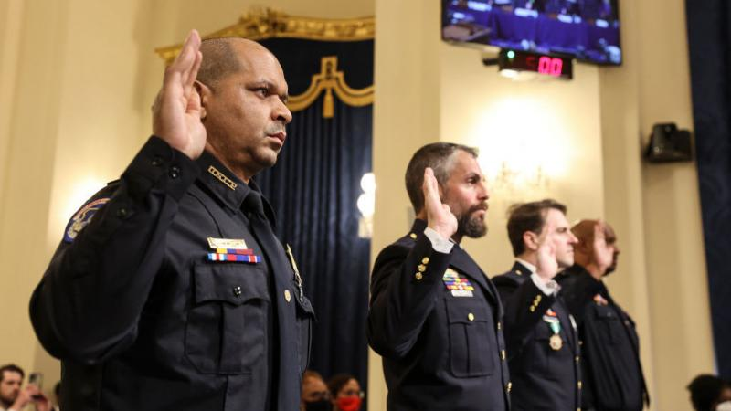 U.S. Capitol Police Sgt. Aquilino Gonell (from left), officers Michael Fanone and Daniel Hodges of the Washington, D.C., Metropolitan Police Department, and Capitol Police Pfc. Harry Dunn are sworn in Tuesday before testifying before the House select comm