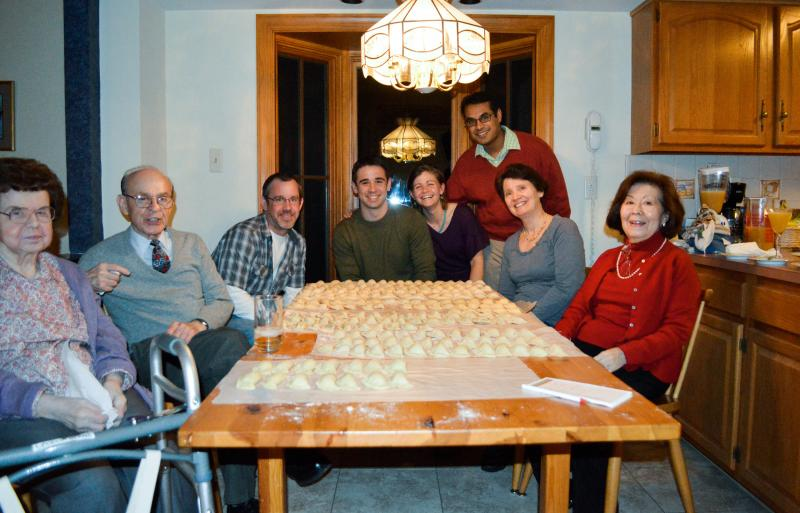 "The author and her family gathered around their prized Christmas Eve pierogi in 2012. On the far left is ""Grandmom"" Cecelia Beans."
