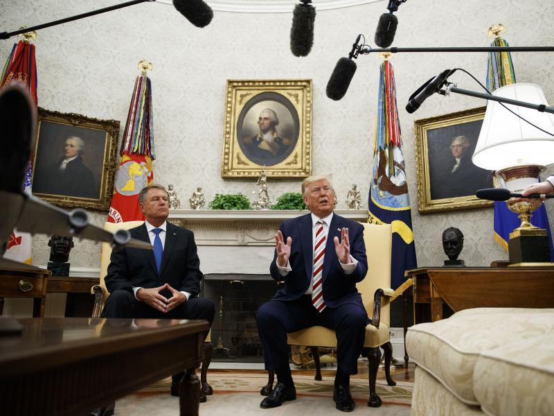 President Trump spoke during a meeting with Romanian President Klaus Iohannis in the Oval Office. He has softened his position on background checks since earlier this month.