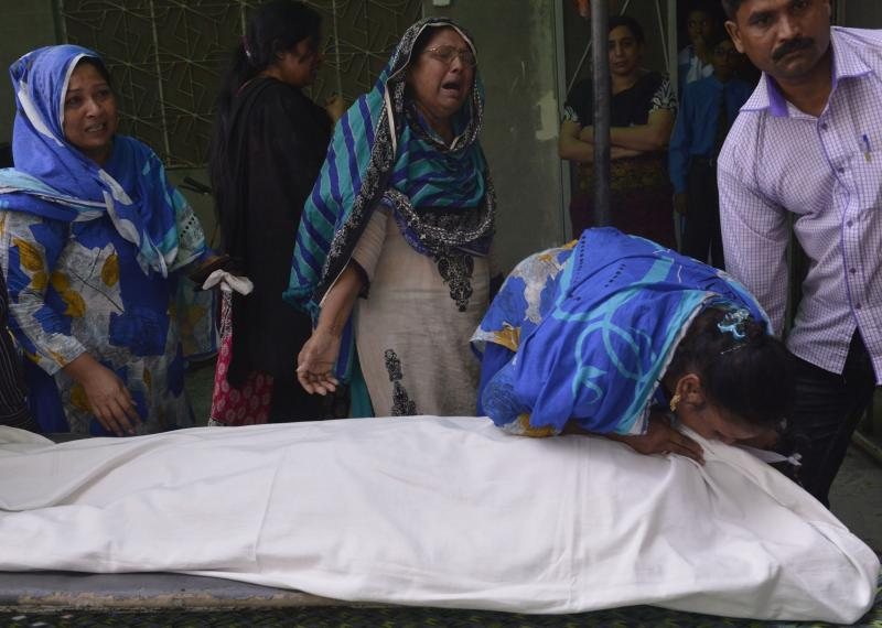 Relatives of convicted murderer Aftab Bahadur mourn beside his body after his execution in Lahore, Pakistan, on Wednesday. Bahadur was just 15 when he was accused of a 1992 murder. Pakistan has executed more than 150 people since lifting a moratorium on t