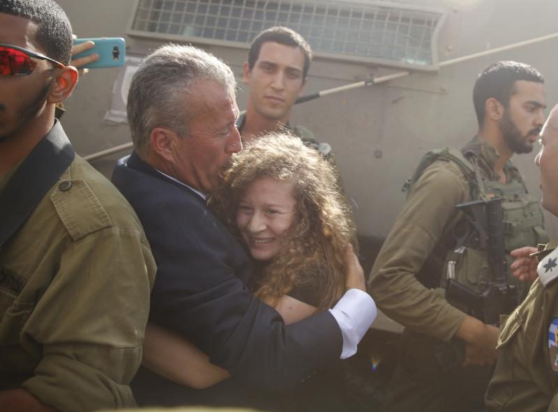 Ahed Tamimi hugs her father Bassem after she was released from an Israeli prison Sunday after serving an eight month sentence.