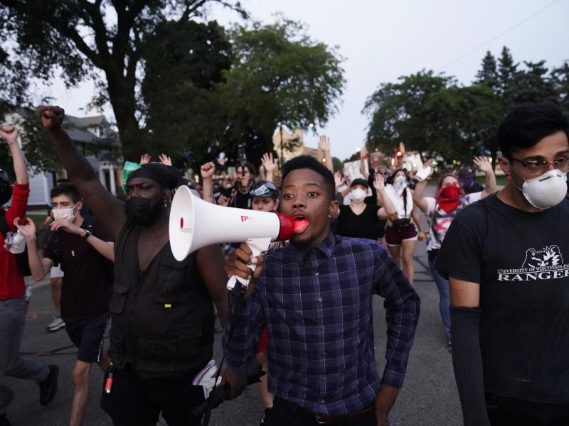 Protesters march on Wednesday against the Sunday police shooting of Jacob Blake in Kenosha, Wis., over the weekend.