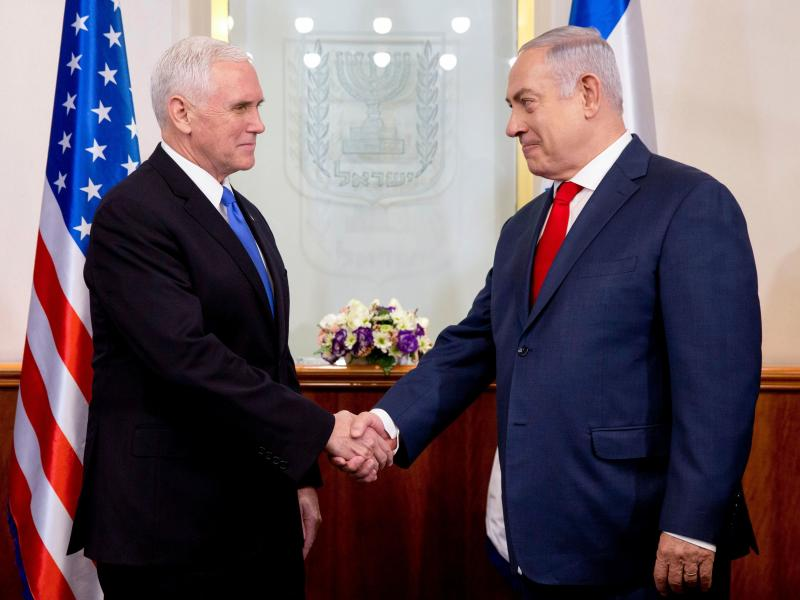 Vice President Pence (left) shakes hands with Israeli Prime Minister Benjamin Netanyahu during their meeting at the prime minister's office in Jerusalem on Monday. The visit, initially scheduled for December before being postponed, is the final leg of a t