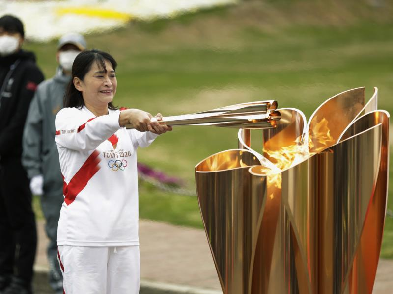 The last Olympic torch relay runner for the Osaka leg concludes the event in Suita, north of Osaka, western Japan, last month.