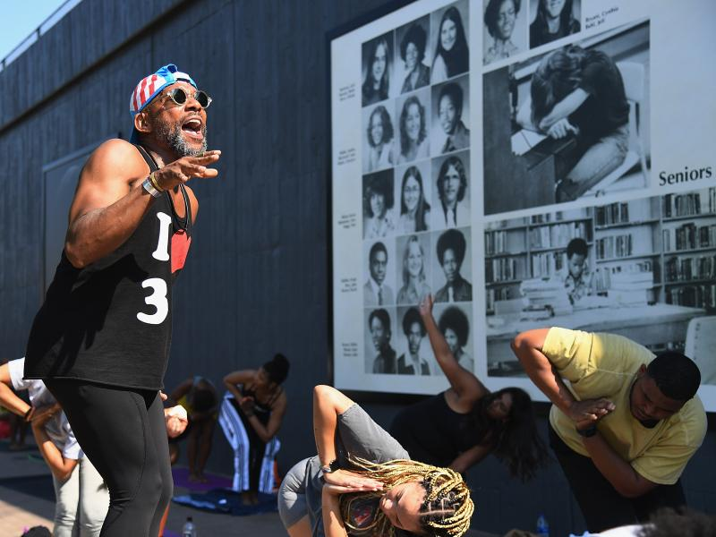 Marlon F. Hall leads a yoga class next to Interstate 244, which runs through the Tulsa neighborhood of Greenwood, the location of the Tulsa Race Massacre 100 years ago. Tulsa's celebration of Juneteenth comes less than three weeks after the anniversary.
