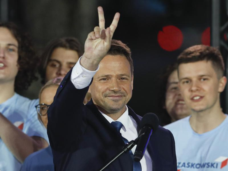 Presidential candidate and Warsaw Mayor Rafal Trzaskowski flashes a victory sign at the end of election day in Warsaw.