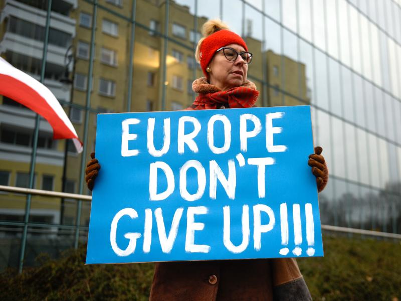 A pro-democracy protestor holds a placard ahead of a meeting between the Vice President of the European Commission for Values and Transparency, Vera Jourova, and the First President of Poland's Supreme Court, Malgorzata Gersdorf, in front of the Supreme C