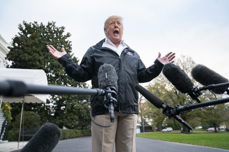 President Trump speaks to reporters before departing the White House for California in November.
