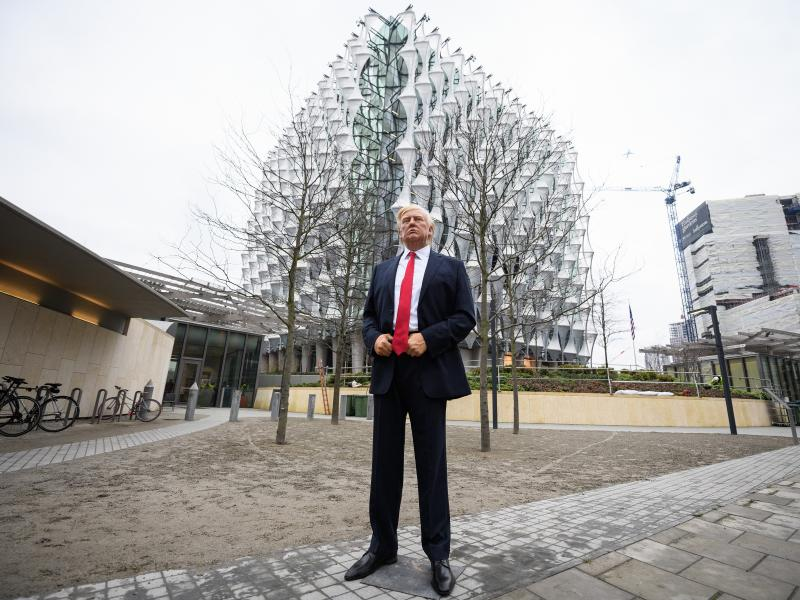 "A model of President Trump from the Madame Tussauds waxwork museum was brought Friday to the new U.S. Embassy in London's Wandsworth borough. ""Trump cancelled his visit so we stepped in!"" Madame Tussauds tweeted."