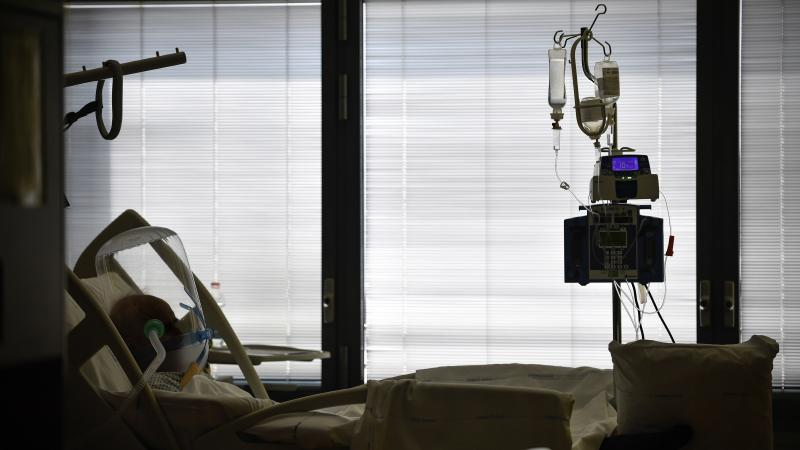 A COVID-19 patient lies in a hospital bed at Papa Giovanni XXIII hospital, in Bergamo, Italy, in April. Prosecutors are investigating whether regional or national authorities mismanaged the response to the coronavirus as it quickly spread through northern