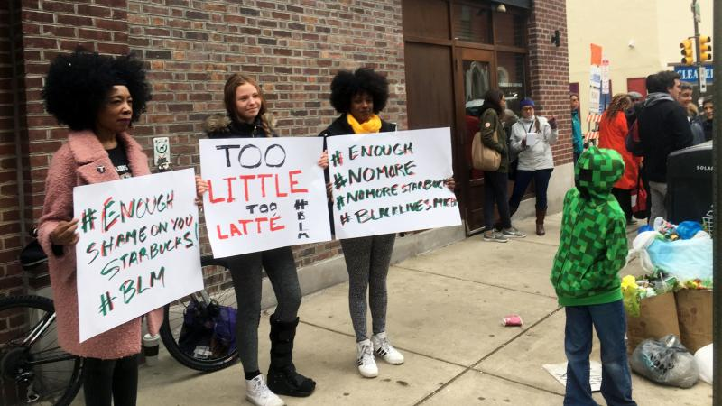 Protesters gather outside a Starbucks in Philadelphia on Sunday, where two black men were arrested Thursday after Starbucks employees called police to say the men were trespassing.