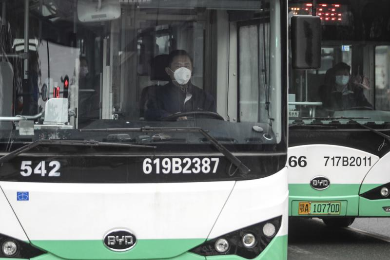 A bus driver wears a mask on Jan. 22 in Wuhan, China. Public transportation is being suspended as of Thursday morning because of concerns about the spreading coronavirus.