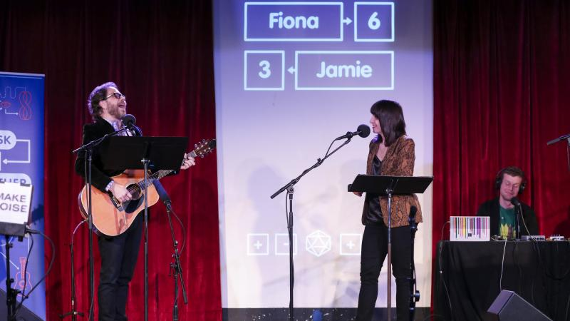Jonathan Coulton leads a music parody game alongside Ophira Eisenberg on Ask Me Another at the Bell House in Brooklyn, New York.