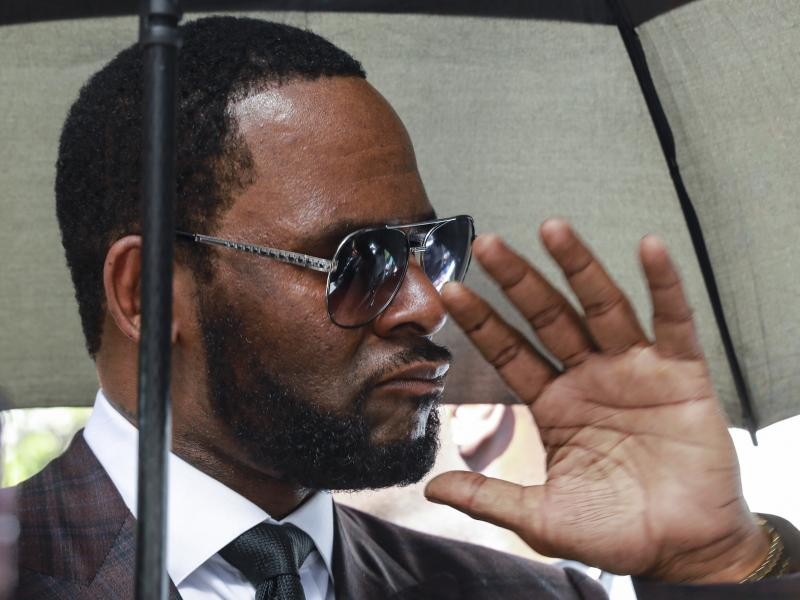 This June photo of R. Kelly shows him departing a courtroom in Chicago in a case related to a state sexual abuse case. On Thursday, federal prosecutors said an additional criminal prosecution against Kelly has been launched.