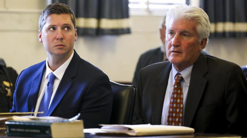 Former University of Cincinnati police officer Ray Tensing, left, faces a murder charge over the death of Sam DuBose. Tensing is seen here during his retrial Friday at the Hamilton County Courthouse in Cincinnati.