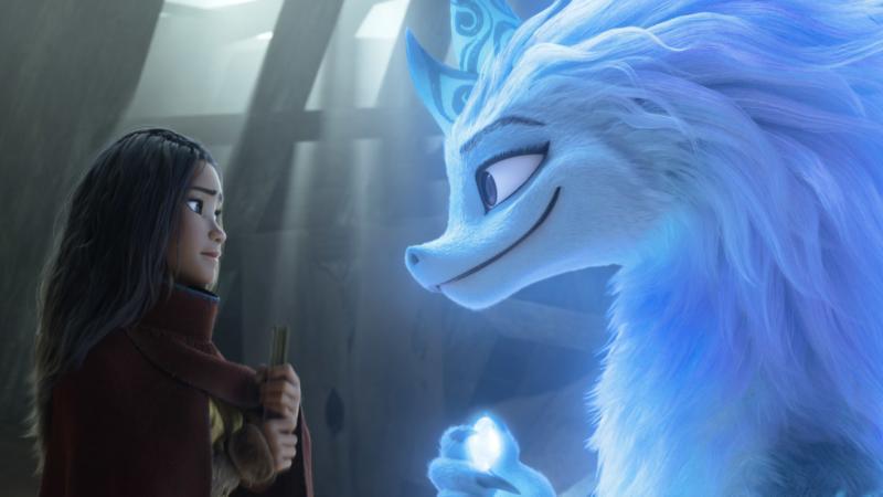 Raya, a young warrior princess (Kelly Marie Tran), enlists the help of Sisu, a friendly water dragon (Awkwafina) in Raya and the Last Dragon.