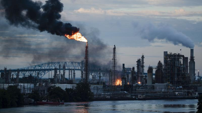 Flames and smoke emerge from the Philadelphia Energy Solutions refinery in Philadelphia on June 21. Experts say the explosions could have been far more devastating if deadly hydrogen fluoride had been released.