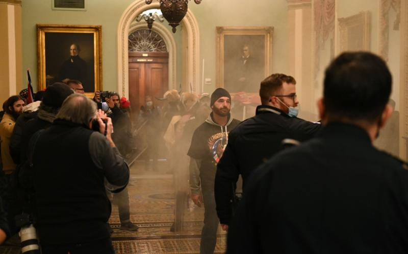 """Supporters of President Trump stormed the U.S. Capitol on Jan. 6. Democratic Rep. Tim Ryan of Ohio says investigators are looking at """"potentially members of Congress"""" who gave tours to rioters prior to the insurrection."""