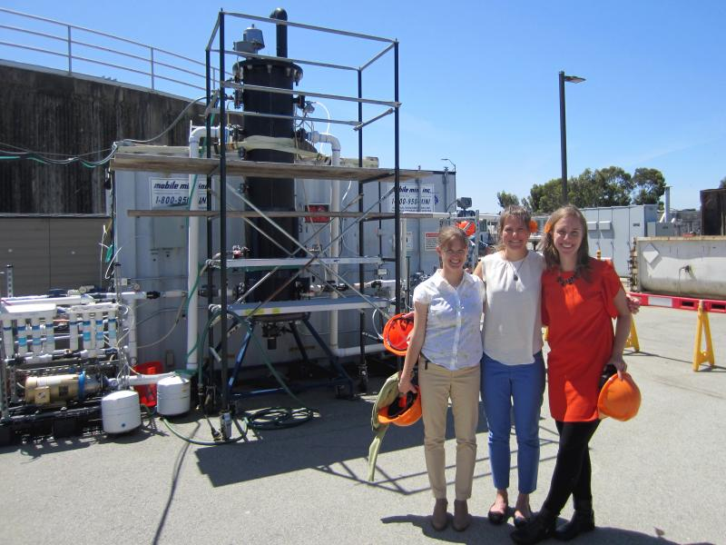 Anne Schauer-Gimenez (from left) Allison Pieja and Molly Morse of Mango Materials stand next to the biopolymer fermenter at a sewage treatment plant next to San Francisco Bay. The fermenter feeds bacteria the methane they need to produce a biological form