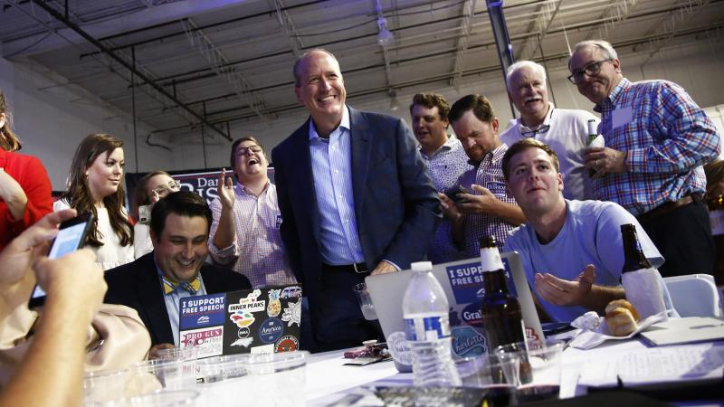 Dan Bishop, center, smiles as he gets up from the table after looking at election results with supporters during an election night party Tuesday in Monroe, N.C. September 10, 2019 in Monroe, N.C.
