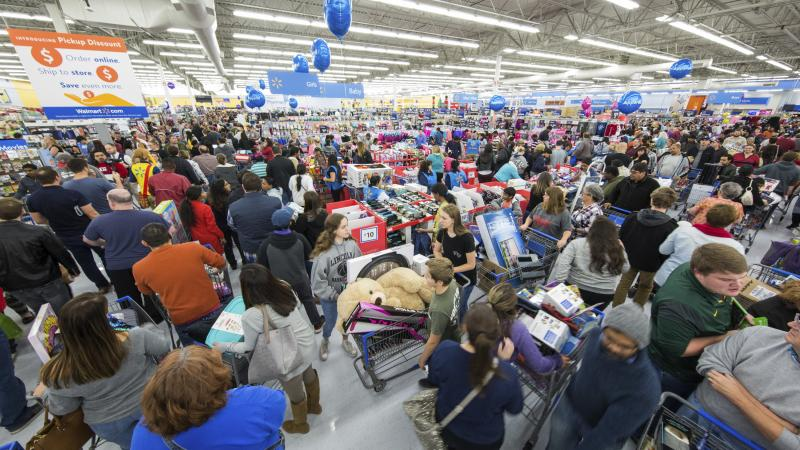 Shoppers fill a Walmart on Thanksgiving day in Bentonville, Ark. Sales in November were up from last year.