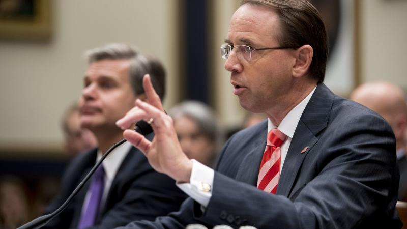 Deputy Attorney General Rod Rosenstein told lawmakers Thursday that he objected to personal attacks about purported Justice Department stonewalling on the Russia investigation. With him is FBI Director Christopher Wray.