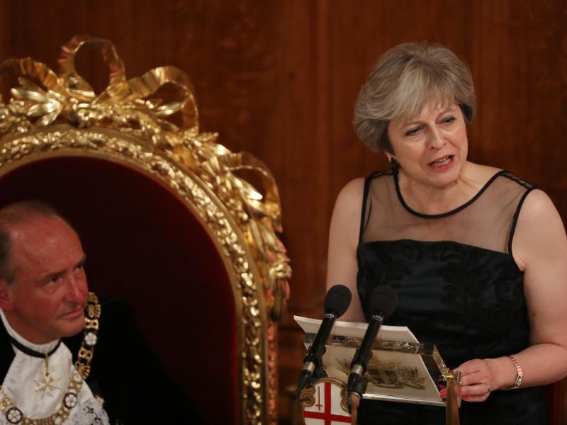 U.K. Prime Minister Theresa May speaks as Charles Bowman, Lord Mayor of the City of London, listens during the annual Lord Mayor's Banquet at the Guildhall, in the square mile financial district of the City of London on Monday.