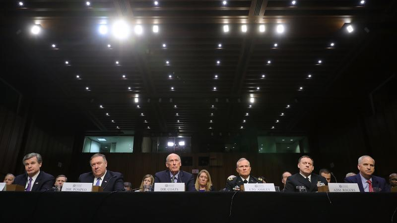 FBI Director Christopher Wray (from left), CIA Director Mike Pompeo, Director of National Intelligence Dan Coats, Defense Intelligence Agency Director Lt. Gen. Robert Ashley, NSA Director Adm. Michael Rogers and National Geospatial-Intelligence Agency Dir