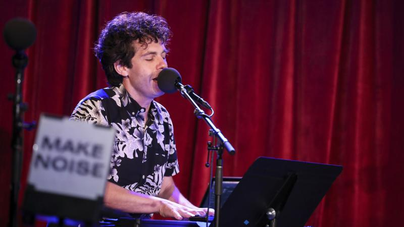 Ask Me Another's guest house musician Julian Velard leads a music parody game at the Bell House in Brooklyn, New York.