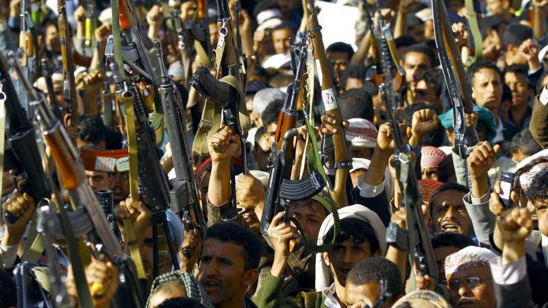 """Supporters of the Shiite Houthi movement brandish weapons as they take part in a demonstration in Yemen's capital of Sanaa on Thursday, protesting the Saudi-led military """"Decisive Storm"""" air campaign."""