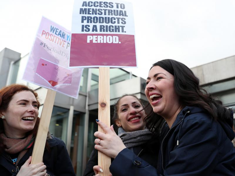 Scottish Parliament member Monica Lennon (right) joins supporters of the Period Products bill she sponsored, at a rally outside Parliament in Edinburgh on Tuesday. The legislation would make Scotland the first country in the world to make products like pa