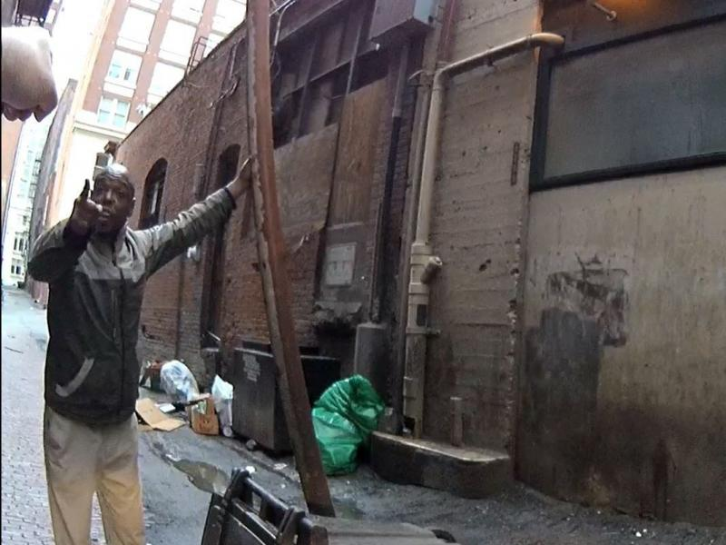 Seattle Police body camera image of a mentally ill man who claimed a downtown alleyway and was chasing people away with a length of drain pipe.